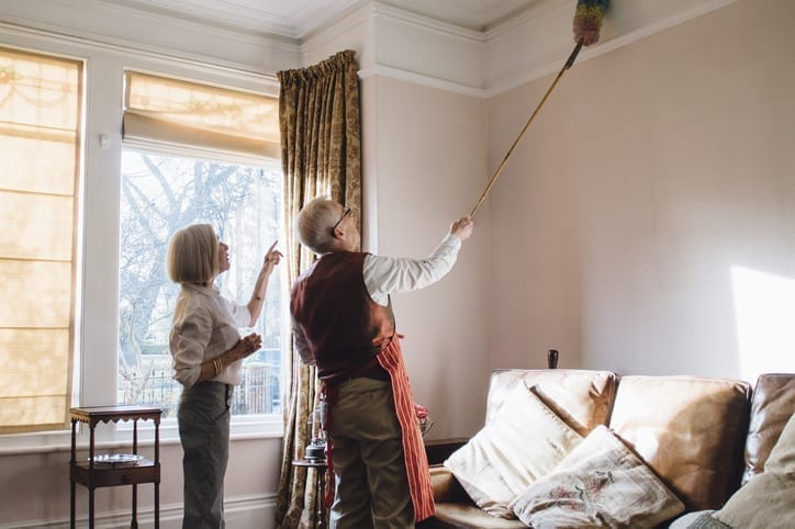 elderly couple spring cleaning