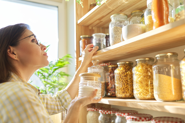 woman clearing out her pantry