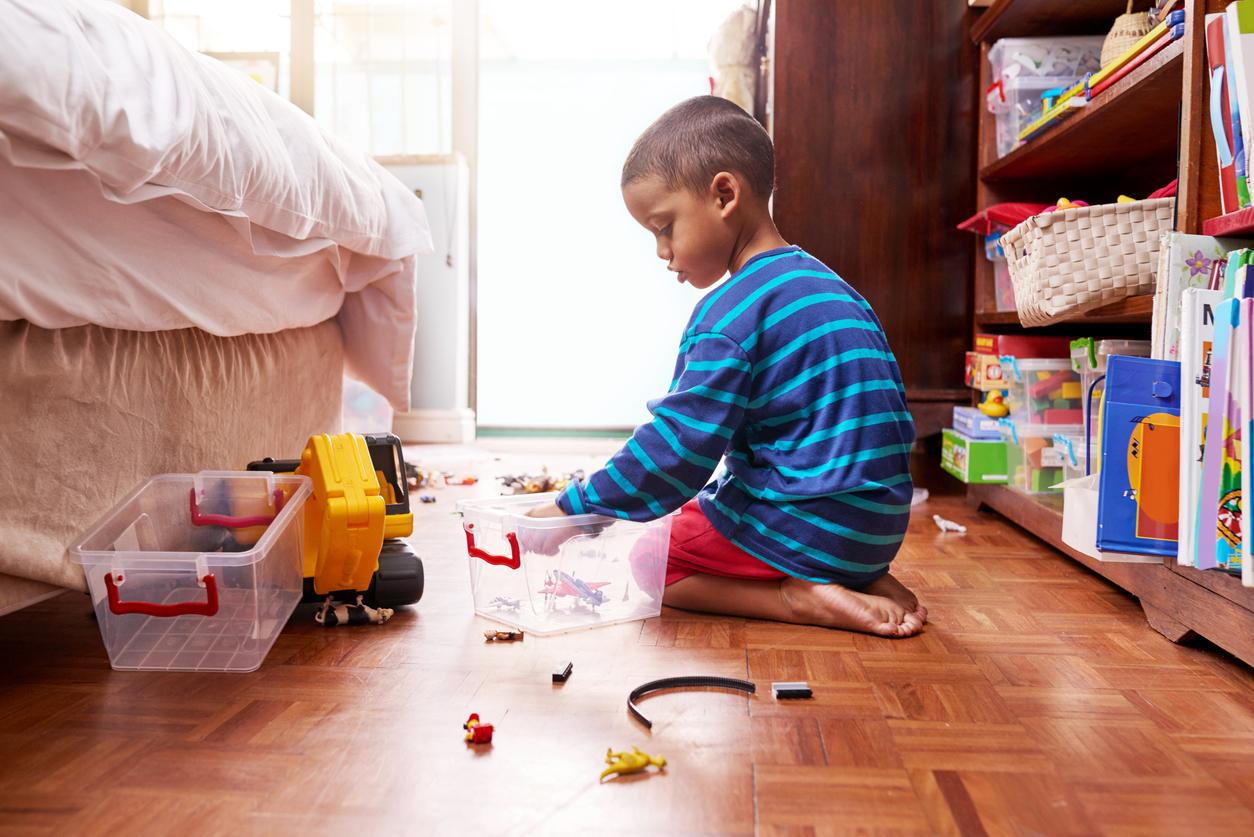Children tidying away toys